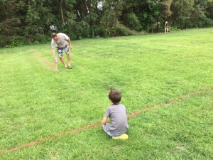 Daddy and Orlando painting the soccer field